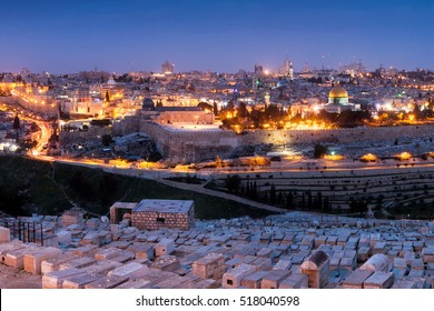 View on Jerusalem old town from the old Jewish Cemetery at Mount of Olives before sunrise.