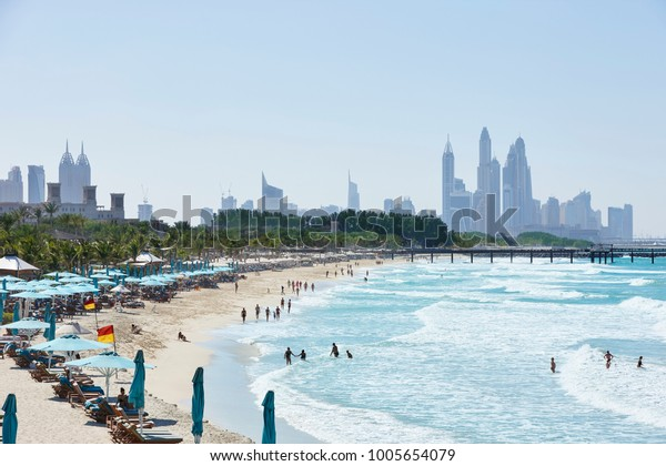 View on Jumeirah Beach with in background Madinat Jumeirah and the skyline of Dubai Marina, Dubai, United Arab Emirates