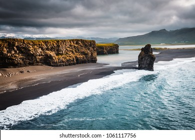 View on Kirkjufjara beach and Arnardrangur cliff. Location Myrdal valley, Atlantic ocean near Vik village, Iceland, Europe. Scenic image of amazing nature landscape. Discover the beauty of earth.
