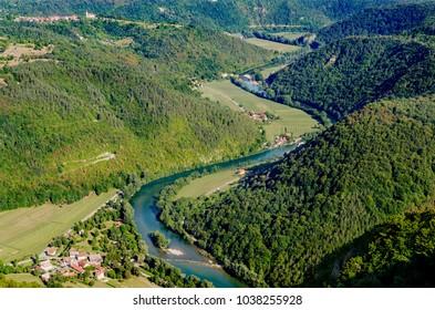 View on Kolpa (Kupa - croatian) river from Kozice mount, Bela Krajina (White Carniola) region in Slovenia, Europe. - Shutterstock ID 1038255928