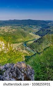 View on Kolpa (Kupa - croatian) river from Kozice mount, Bela Krajina (White Carniola) region in Slovenia, Europe. - Shutterstock ID 1038255931
