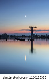 View on  the lake and moon at sunset in Ivano - Frankivsk