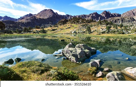 view on a lake in pyrenees mountains