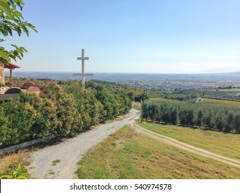 View on landscape with big cross in foreground. St. Ephrem the Syrian monastery, Kondariotissa, Pieria, Greece.