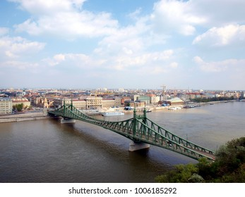 View on Liberty Bridge on Danube river in Budapest, Hungary. Blue sky with whit clouds.
