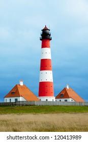 View on the lighthouse Westerheversand near the North Sea