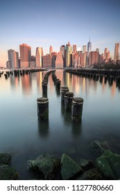 View on Lower east manhattan from broken pier at sunset