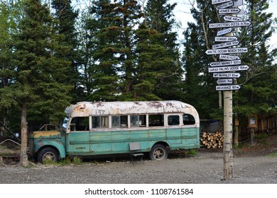 view on magic bus in alaska with road signs