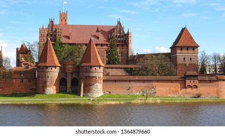 view on Malbork castle and river Nogat, famous medieval castle built in 13th century by Order of Teutonic knights and never conquered, located in Zulawy region, northern Poland, Eastern Europe