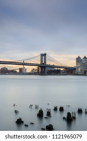 View on Manhattan bridge from broken pier during sunrise