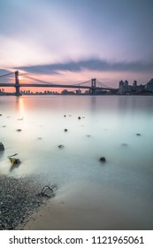 View on Manhattan bridge from east river during sunrise