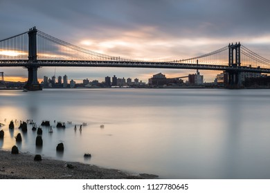 View on the Manhattan bridge from east river at sunrise