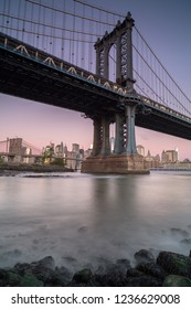 View on Manhattan bridge from east river at sunrise