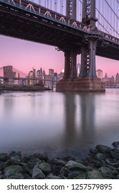 View on Manhattan Bridge and financial district at sunrise with