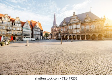 View on the Market square with city hall, old church and beautiful buildings during the morning light in Bremen city, Germany