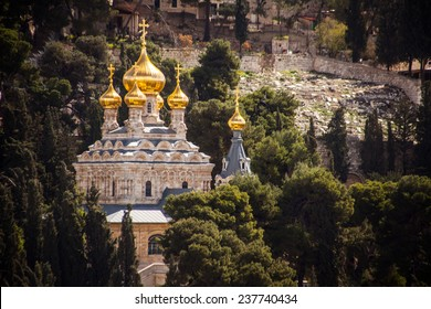 View on Mary Magdalene s cathedral of Russian Orthodox Gethsemane convent among trees on Mount of Olives slope. Jerusalem, Israel.