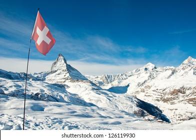 View on Matterhorn, swiss flag and Riffelberg ski station