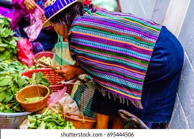 View on Maya woman on market in Chichicastenango in Guatemala