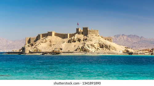 View on medieval Citadel of Saladin on the Pharaoh's Island in the Gulf of Aqaba in Taba region. Old fortress of Sultan Salah ad-Din, ancient monument of an arabic history on Sinai Peninsula, Egypt.