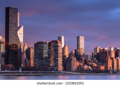 View on Midtown Manhattan  from east river at sunrise with long exposure