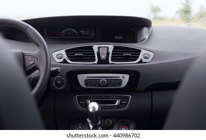 view on modern front driving panel of car with speed control, touchscreen, multimedia computer from passenger place