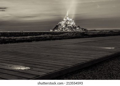 View on Mont Saint Michel with walking path, sepia toned, Normandy, France