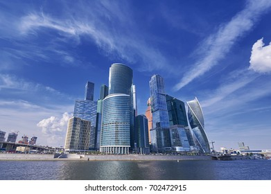 View on Moscow City business center skyscrapers office buildings, luxury apartments, Bagration bridge across river. Moscow city skyscrapers panorama. Modern european russian architecture cityscape