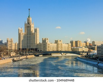 View on the Moskvoretskaya embankment and high-rise building on the Kotelnicheskaya embankment and Moskva-river. Winter cityscape. Moscow, Russia