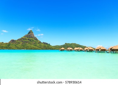 View on Mount Otemanu through turquoise lagoon and overwater bungalows on the tropical island Bora Bora, Tahiti, French Polynesia, Pacific ocean.