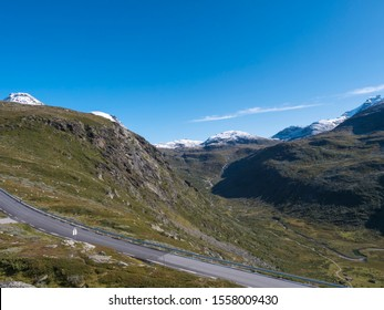 View on mountain landscape in summertime with snowy peaks and glaciers. National tourist scenic route road 55 Sognefjellet between Lom and Luster, Norway.