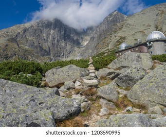 View on mountain Peak Lomnicky stit 2 634 m covered in clouds at Summer with Skalnate pleso Observatory, second highest mountain peak in the High Tatras mountains of Slovakia, Vysoke Tatry
