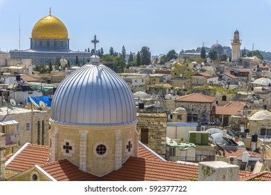 A view on n rooftops of Old City of Jerusalem. Grey dome of Church of Our Lady of the Spasm (Armenian church) and golden Dome of the Rock.