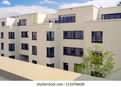 View on new build modern luxury houses, Apartment and flat, sunny day, green tree front right