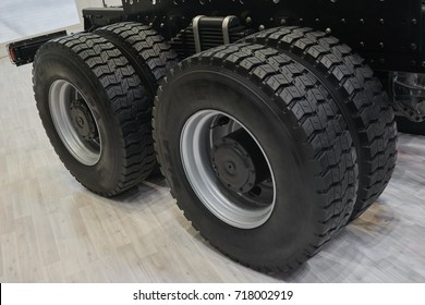 View on new truck wheels and tires on truck chassis. Truck wheel rim. Truck chassis parts details devices equipment. New wheels and tires on axles. Car chassis