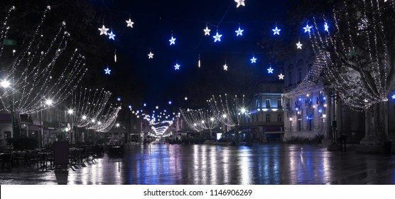 View on the New Year's illuminated streets of Avignon  at evening, France