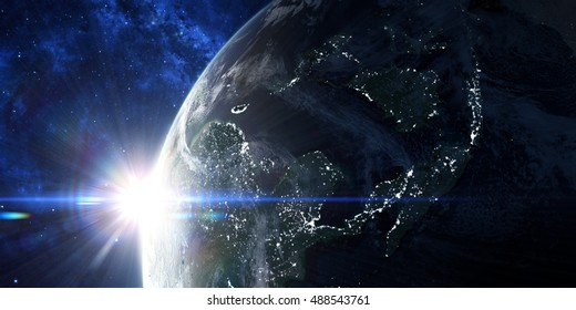 View on the night Earth with city lights. Sunrise in space with prominent sun flare and sun streaks. Asia region. Elements of this image furnished by NASA. 3d illustration