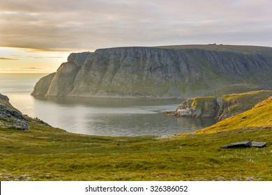 View on North Cape (Nordkapp) cliff, the northernmost point of Europe in the midnight sun light, Norway