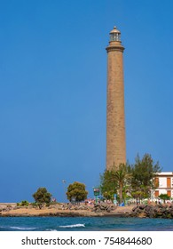 View on the old Faro de Maspalomas, an active 19th century lighthouse at the southern end of the Spanish island of Gran Canaria. Maspalomas, Grand Canary, Spain - July 18 2017.