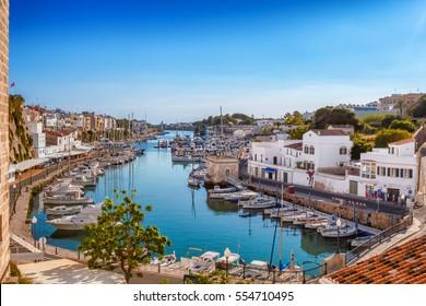 View on old town Ciutadella sea port on sunny day, Menorca island, Balears, Spain.