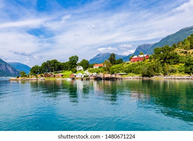 View on Ornes, famous for Urnes Stave Church, from the liitle ferry crossing Lustrafjorden between Solvorn and Ornes, Sogn og Fjordane in Norway.