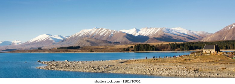 View on picturesque Lake Tekapo with its special blue color. Lake Tekapo is on the South Island of New Zealand, the Mackenzie district, Canterbury Region. Visible is the Church of the Good Shepherd.