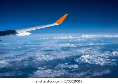 view on plane wing above the earth