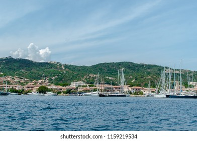 View on Port of Italian small town Cannigione from the sea, sailing boats in the harbor