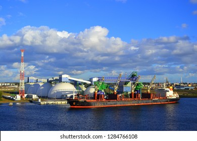 View on the port taps in the river port of Daugava, in Riga - September 23,2018 . The chemical substances transfer terminal can be seen in the background
