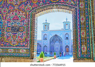 The view on the portal of Nasir Ol-Molk mosque with two small minarets and muqarnas decoration, Shiraz, Iran.