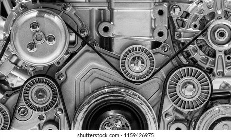 View on pulley and belts on a car engine.