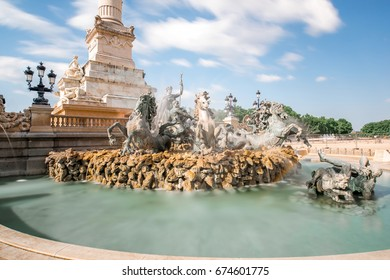View on the Quinconces square with Girondins fountain in Bordeaux city in France. Long exposure image technic with motion blurred clouds
