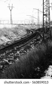 View on a railroad track and electrical line