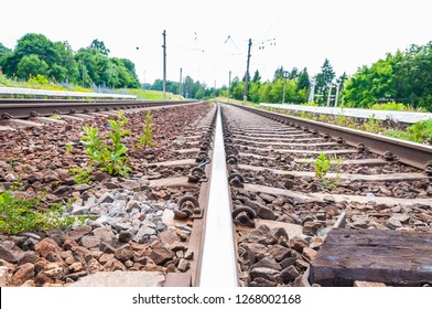 View on rails and sleepers of a two ways railroad in Lithuania