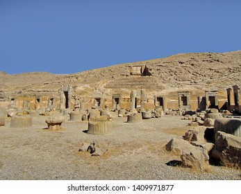 View on remains of royal Palace of 100 columns in Persepolis, ancient capital of Persia. Unfinished tomb of King Darius III is on background. Persepolis located near Shiraz, Iran